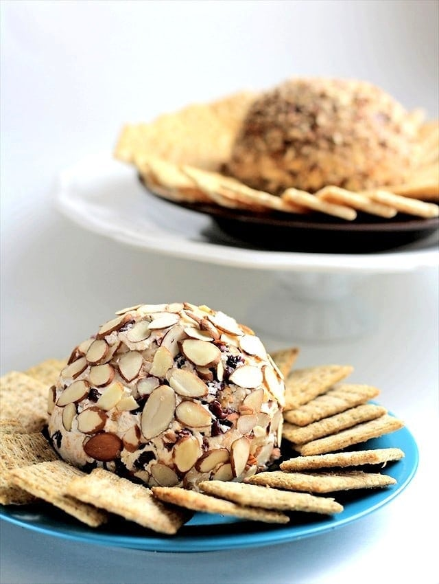 I didn't grow up with a tradition of having a cheese ball during the holidays but I bought one several years ago and was immediately sold. They're so good! I don't know what it is about them, but they're easily one of my favorite appetizers. I no longer buy them though! They're so easy to make and you can change the ingredients to suit your family's tastes. Here's a basic, 3 ingredient recipe, plus my two favorite add-ons down below.