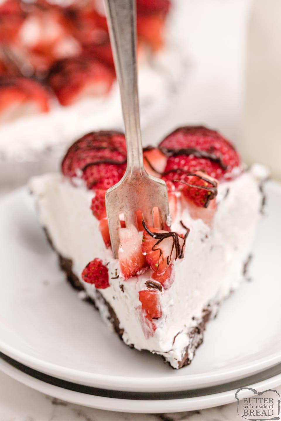 Bite of creamy strawberry pie