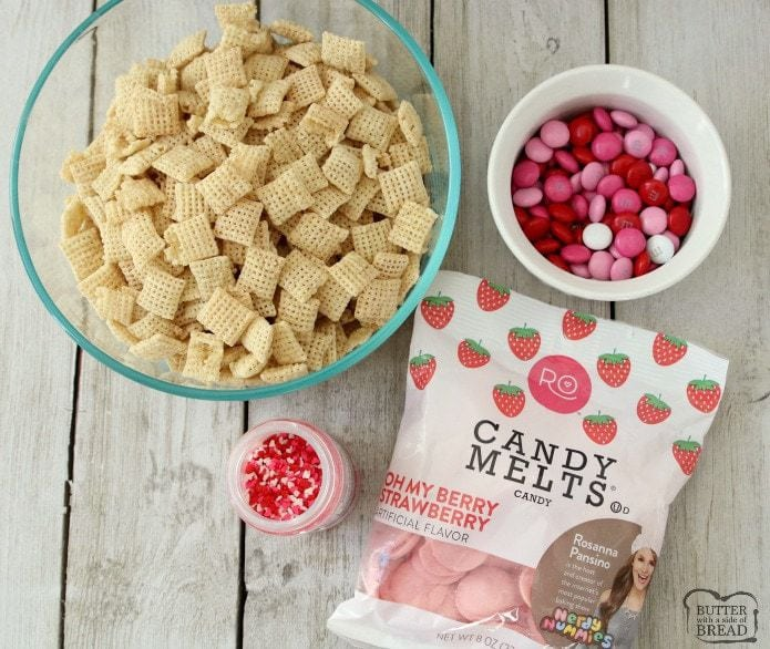 Strawberry Valentine Chex Mix is easy to make, fun & perfectly festive for Valentines Day! Strawberry white chocolate coating on Chex cereal with added chocolate candy is the perfect sweet treat!