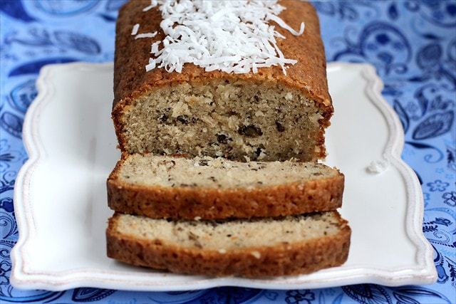 Sweet Coconut Bread is made with buttermilk, coconut, and pecans for a moist slice of bread with a bit of crunch and a taste you won't be able to resist!