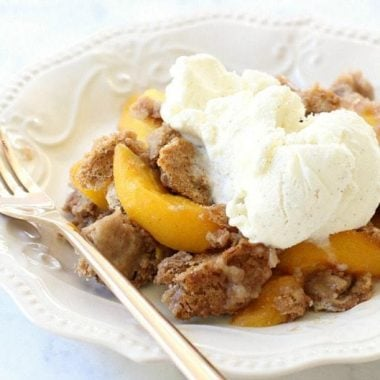 Peach Cobbler with Cake Mix could not be any simpler to make! All it takes is a cake mix + peaches + a can of soda + cinnamon. Delicious and easy peach cobbler recipe!