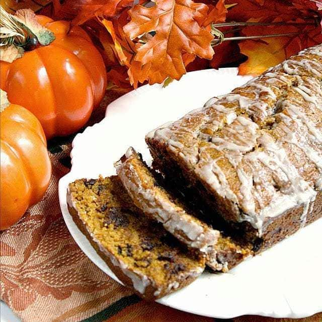 Pumpkin Chocolate Chip Bread is the perfect pumpkin bread recipe! The vanilla glaze on top is simple and delicious and adds a little bit of extra flavor too!