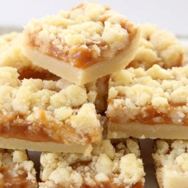 Salted Caramel Bar recipe made with a sweet shortbread crust & topped with smooth caramel and sea salt. Perfectly indulgent caramel butter bar dessert!