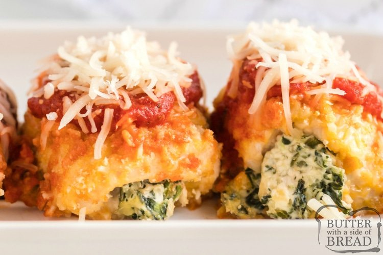Baked Chicken Parmesan Bundles are stuffed with spinach & cheese then breaded, baked and topped with flavorful marinara sauce. Perfect baked chicken parmesan dinner recipe.