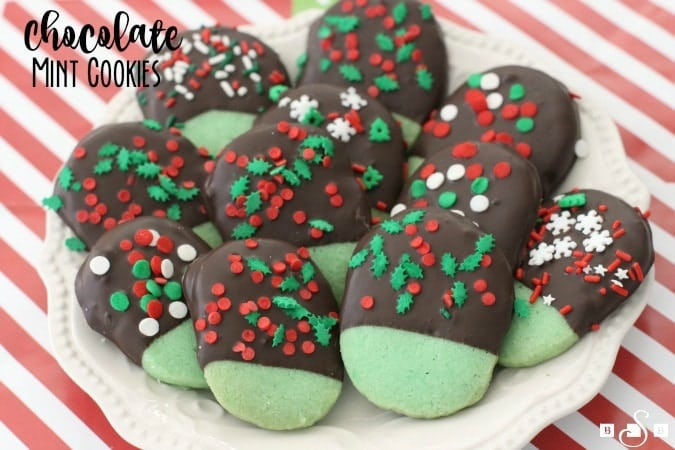 Chocolate Mint Cookies made from a buttery shortbread cookie dipped in dark chocolate & topped with festive holiday sprinkles. My favorite Christmas cookie!