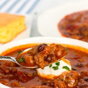 Crockpot Chili recipe that's made with beef, pork and bacon and has a fantastic bold flavor. This 3 meat slow cooker chiliis thebest chili recipethat serves a crowd!