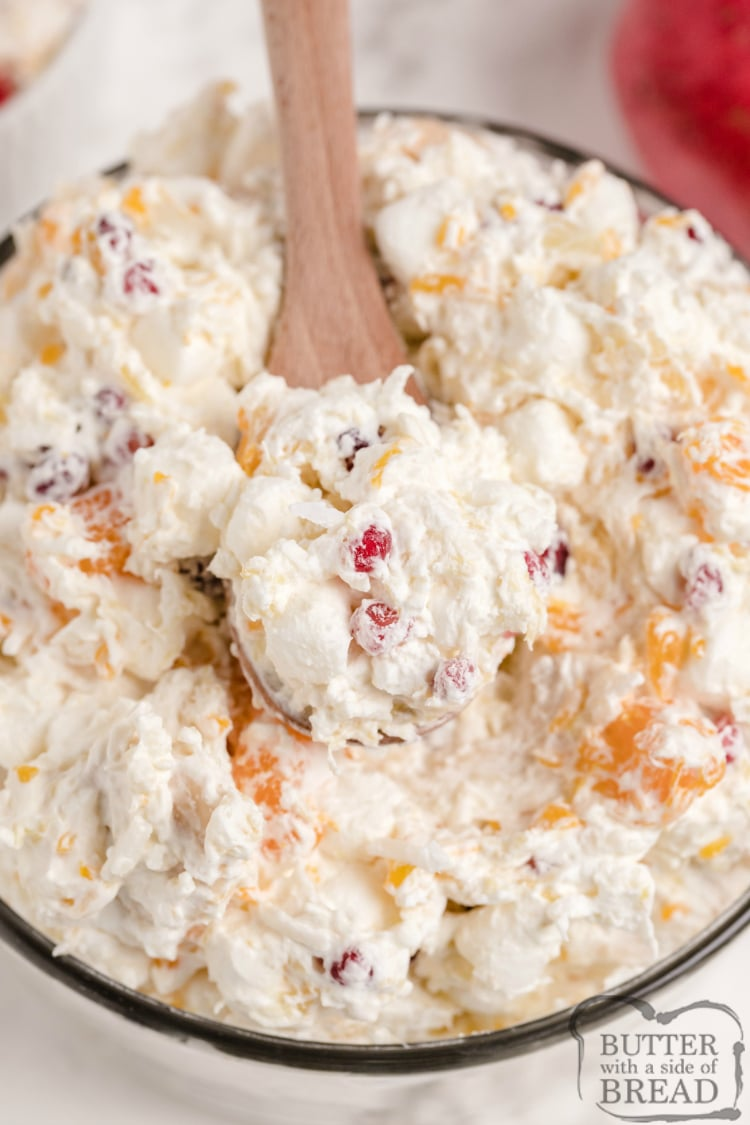 Fall fruit salad recipe with whipped cream and pomegranates
