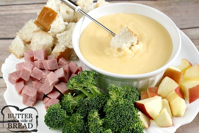 Swiss cheddar cheese fondue butter with a side of bread this creamy swiss cheddar cheese fondue is an easy cheese fondue recipe that is perfect forumfinder Choice Image
