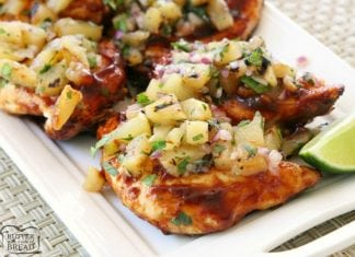 Easy Grilled Chicken smothered with thick & flavorful bbq sauce then topped with a delicious pineapple salsa is what's for dinner! Perfect for weeknight dinners or weekend get-togethers, the pineapple salsa pairs perfectly with the tangy grilled barbecue chicken.