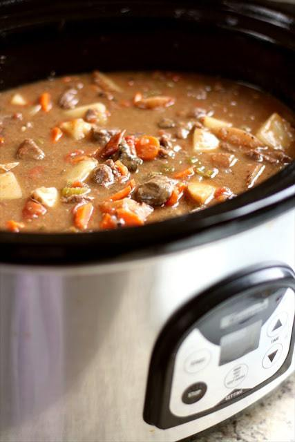 Crock Pot Beef Stew made with tender chunks of beef, loads of vegetables and a simple mixture of broth and spices that yields the BEST, easiest beef stew ever!