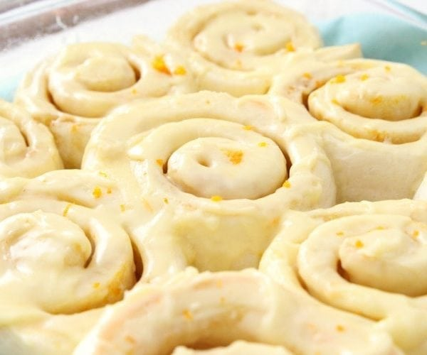 Orange Rolls made in an hour! Perfectly sweet, soft rolls with a bright citrus glaze that melts in your mouth. Plus, how to make the BEST sweet rolls ever!