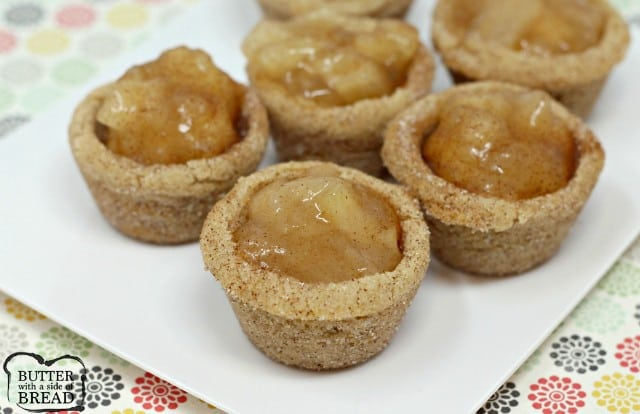 Snickerdoodle Apple Pie Cookie Cups combine two favorite desserts in a bite sized treat! Mini apple pies with a snickerdoodle cookie crust!