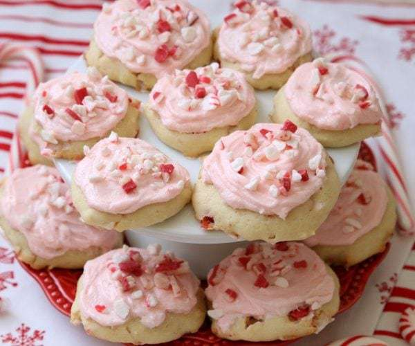 Frosted Peppermint Cookies are soft, pillowy cookies baked with peppermint candy and topped with peppermint vanilla buttercream and candy cane pieces.