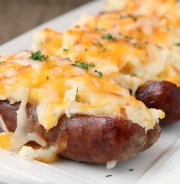 Sausage Potato Boats are an easy weeknight dinner made with juicy sausages topped with buttery mashed potatoes and lots of cheese! Simple & flavorful meal!