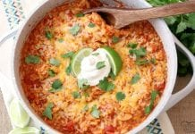 Cheesy Chicken & Spanish Rice is a quick & easy weeknight meal! Great flavor in this comforting One-Pot Spanish Rice recipe with added chicken and cheese. Can be made on the stove or in an Instant Pot!