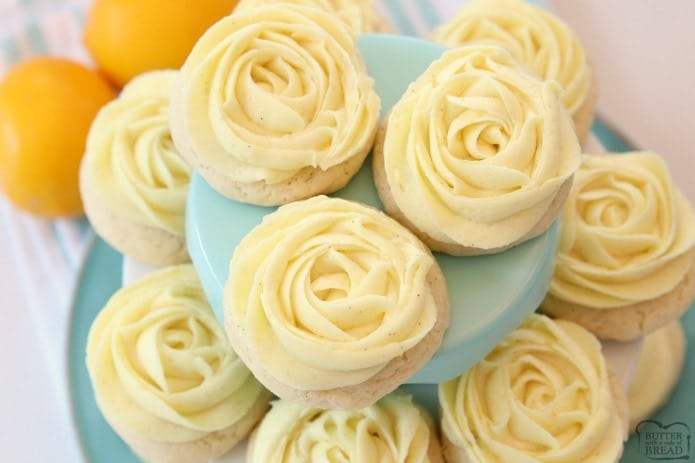 Lemon Cookies made with fresh lemon juice and zest in a soft sugar cookie dough and topped with a bright lemon buttercream frosting. Lemon Sugar Cookies are piped with a super simple rosette so they taste incredible and they're pretty too! No rolling and chilling necessary- just scoop, bake, cool and frost.