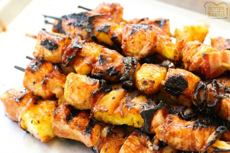 BBQ Chicken Kabobs recipe with tender chicken grilled with pineapple and bacon then slathered with your favorite BBQ sauce. These ultimate BBQ recipe for grilled chicken kabobs are perfect for your next cookout!