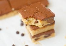 Peanut Butter Chocolate Chip Cookie Bars are made with soft sugar cookie dough mixed with peanut butter and chocolate chips. The bar is finished off with a creamy chocolate frosting to create the ultimate peanut butter chocolate chip cookie experience.