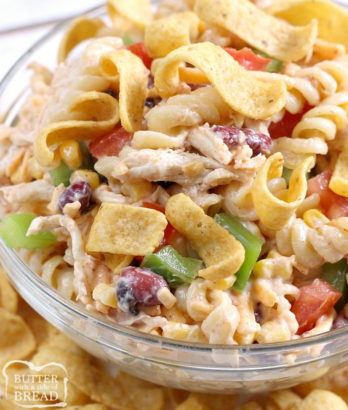 Fiesta Ranch Chicken Pasta Salad is full of fresh southwestern flavors with black beans, corn, cheese and tomatoes. This hearty chicken pasta salad recipe topped with Fritos is perfect as a main dish or a side dish for potlucks and parties!