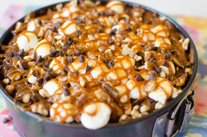 Rocky Road Cheesecake is full of chocolate, caramel, marshmallows, and pecans.