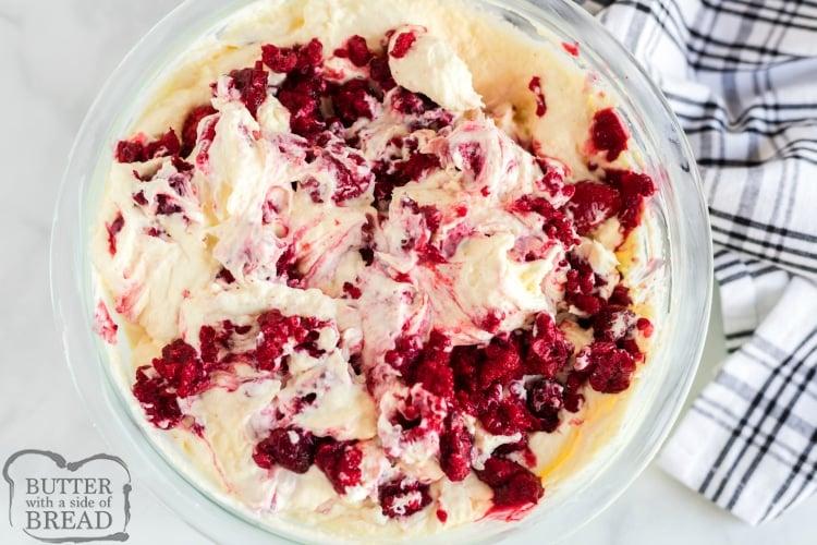 Mixing raspberries into the jello salad recipe