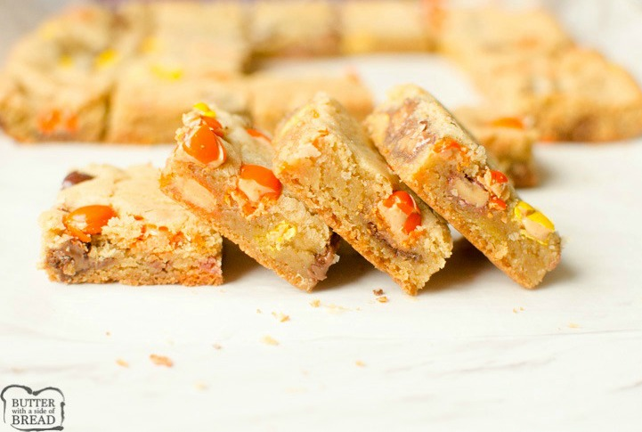 Reese's Cookie Bars are a thick, chewy & full of Reese's Pieces and Mini Reese's Cups! The rich, chewy cookie bar compliments the chocolate & peanut butter add in's perfectly. No rolling required, Cookie Bars are the way to go!