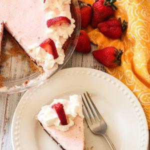 slice of strawberry ice cream pie on a white plate
