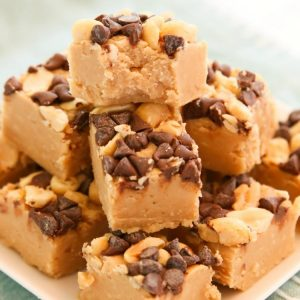 Quick & Easy Peanut Butter Fudge recipe that's done in minutes! Simple ingredients combined in the microwave for a fast, delicious peanut butter treat.