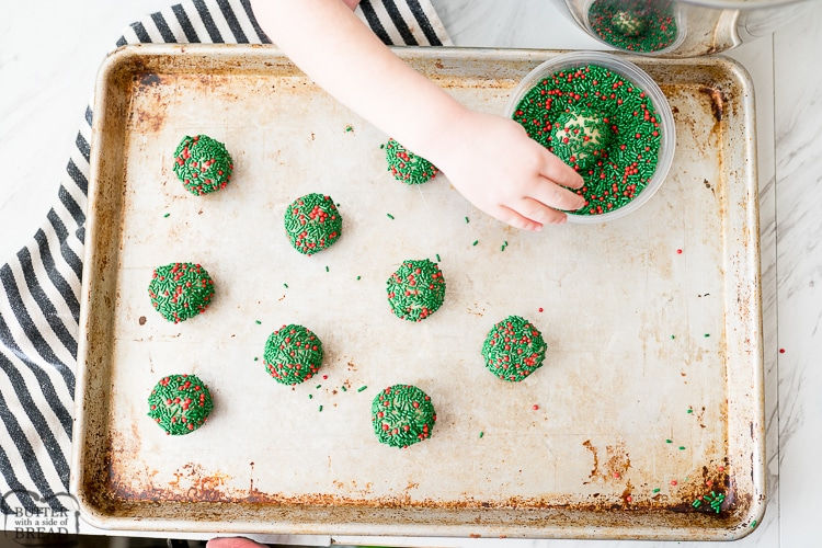 rolling the sugar cookie dough in sprinkles