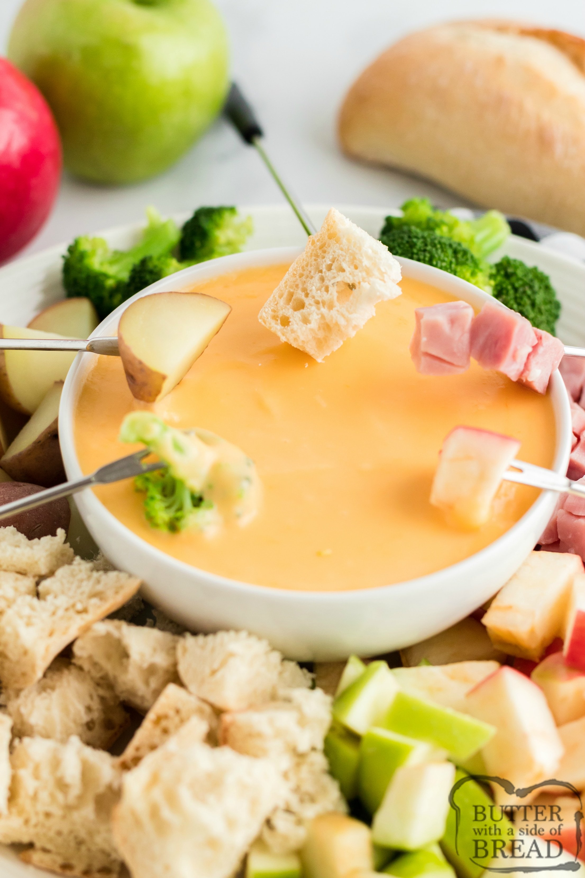 Dipping bread and vegetables in fondue