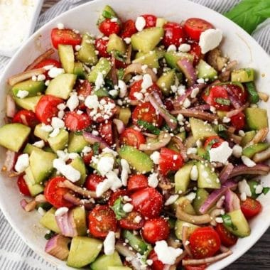 Cucumber and Tomato Salad is a simple, healthy salad made in minutes with just 8 ingredients! Fresh flavors and tangy dressing make this easy salad recipe a hit!