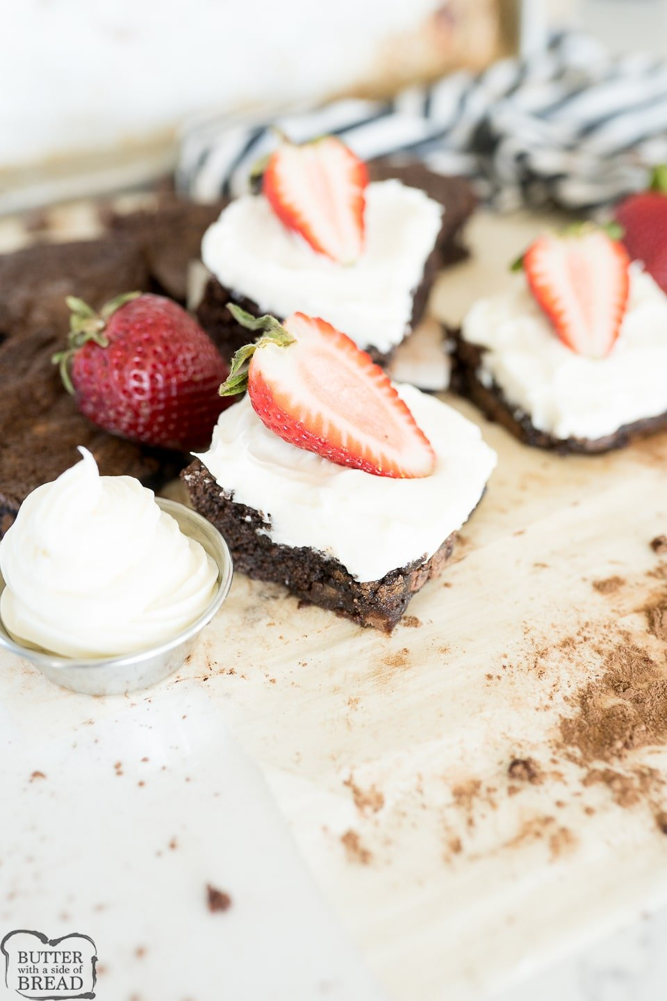 brownie with cheesecake frosting and strawberries