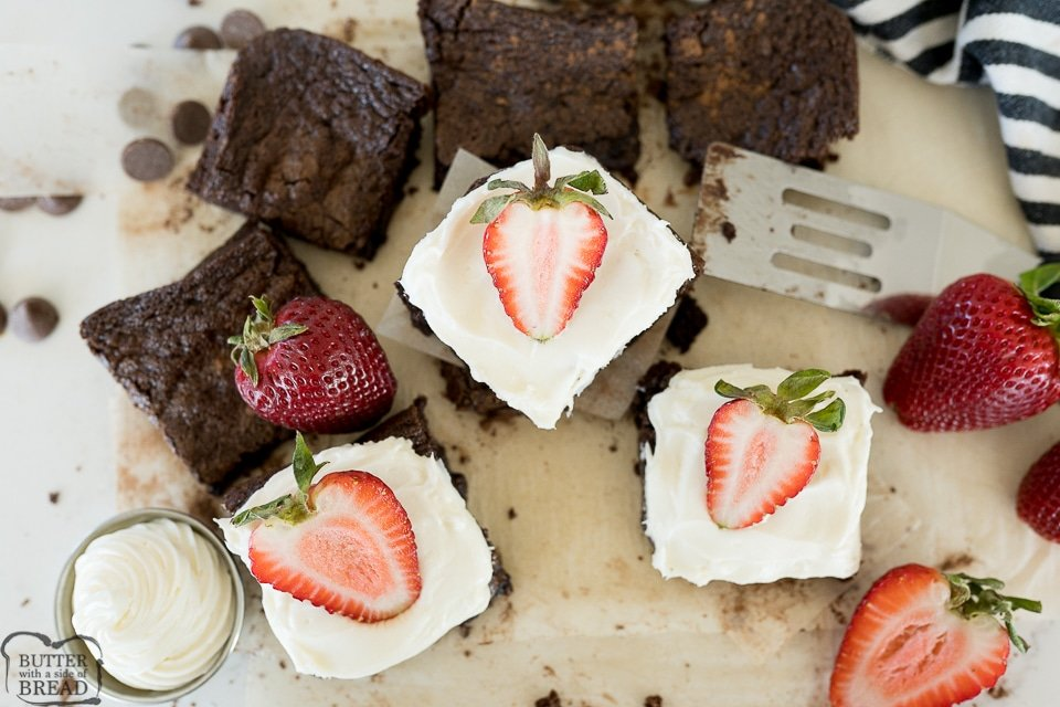 brownies with cream cheese frosting and strawberries