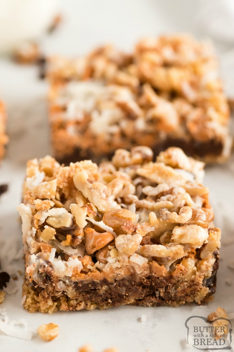 7 Layer Magic Cookie Bars made with graham cracker crumbs, chocolate chips, butterscotch chips, coconut, walnuts and sweetened condensed milk. 7 Layer Bars are a favorite holiday treat that everyone loves!