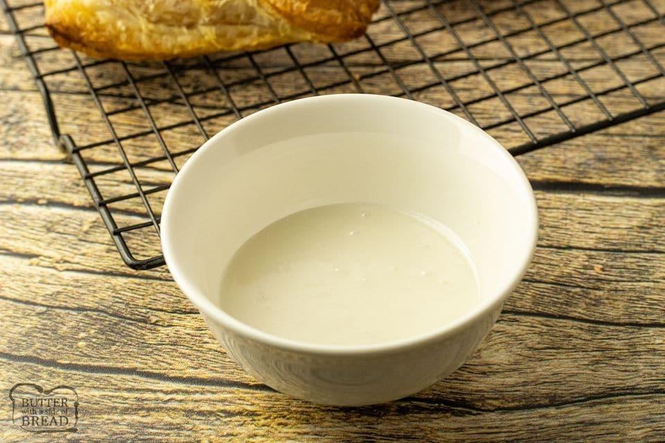 white bowl of almond glaze