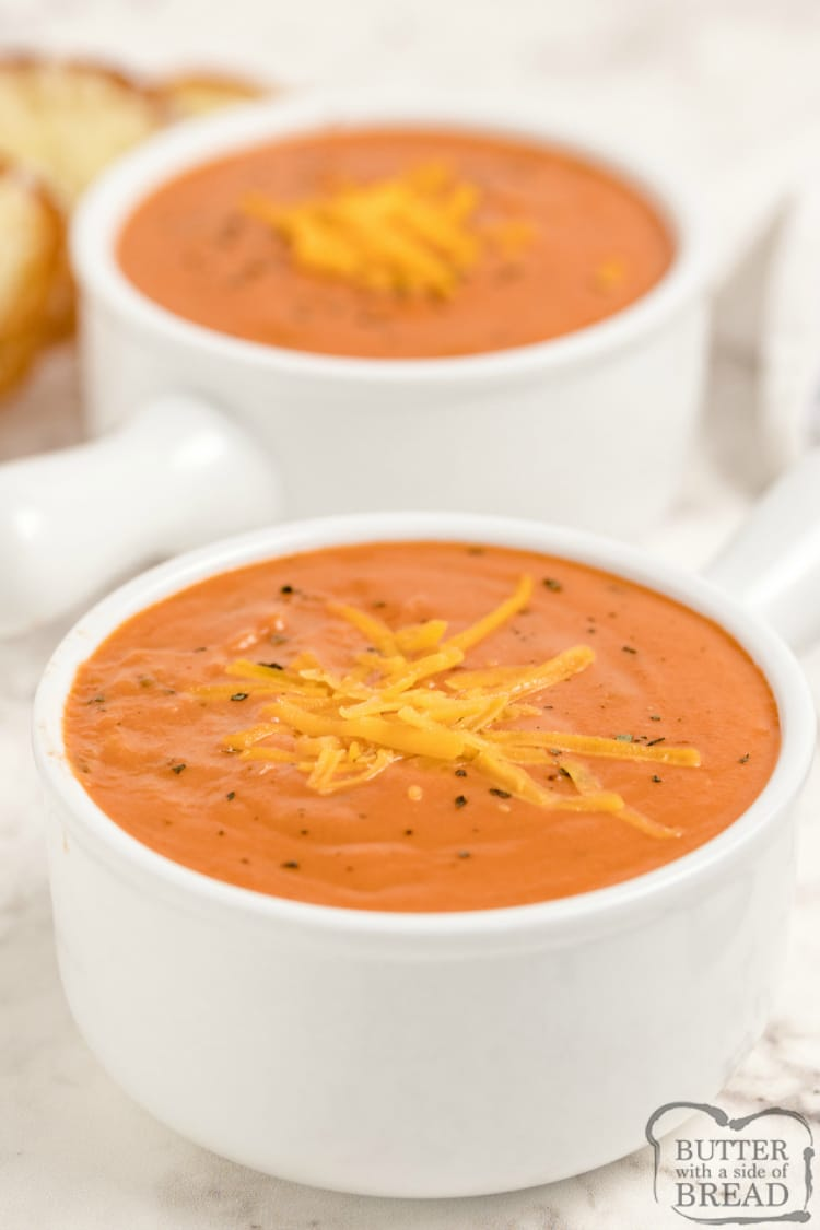 Cheesy Tomato Soup is smooth, creamy and so easy to make! Tomatoes, melted cheddar and sauteed veggies give this easy tomato soup recipe tons of flavor.