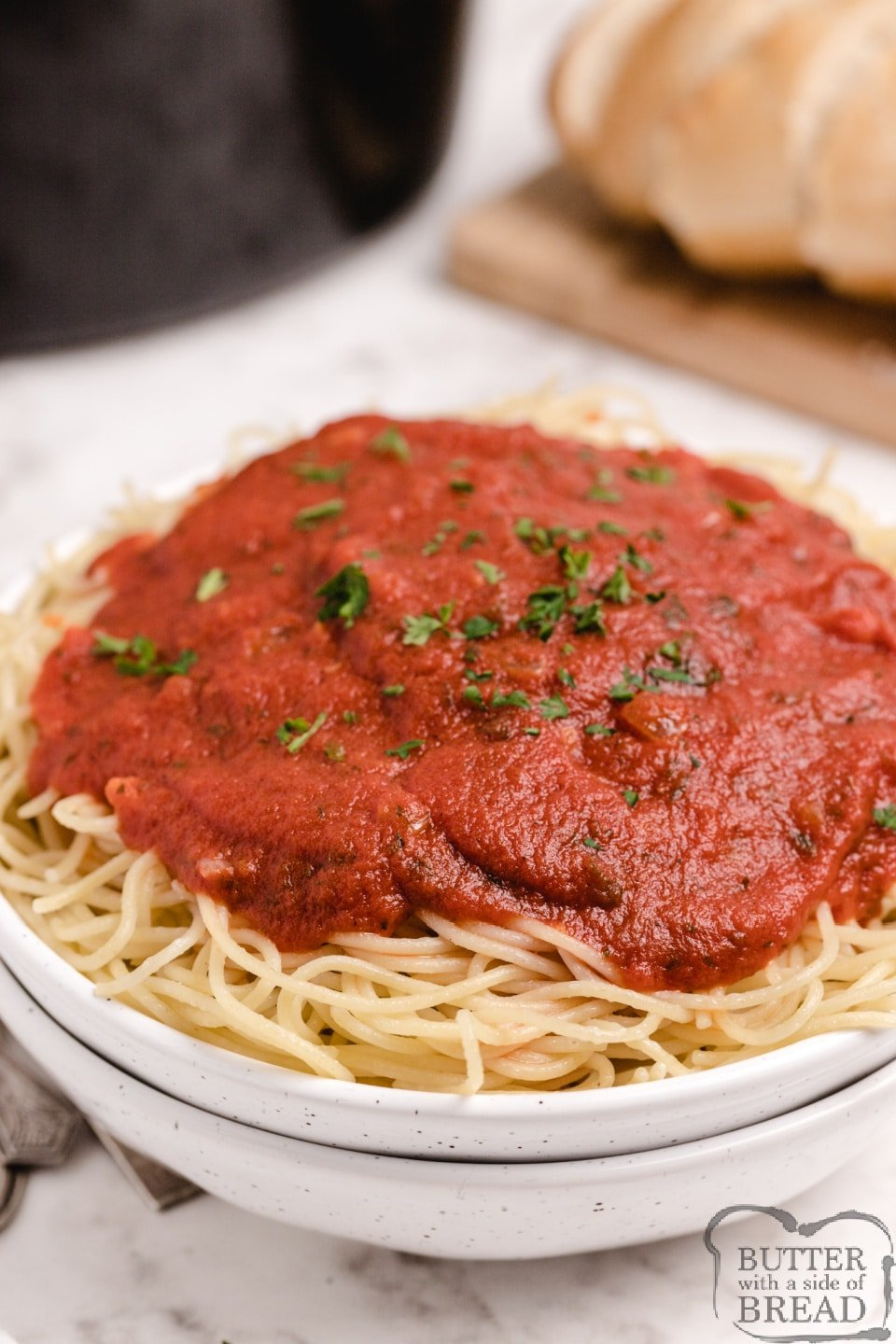 Bowl of spaghetti with homemade spaghetti sauce made in a slow cooker