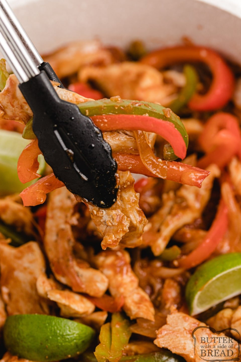 Easy Chicken Fajitas made with peppers, onions and a secret ingredient that takes the flavor over the top. Quick chicken dinner recipe that can be prepped and ready in less than 30 minutes!