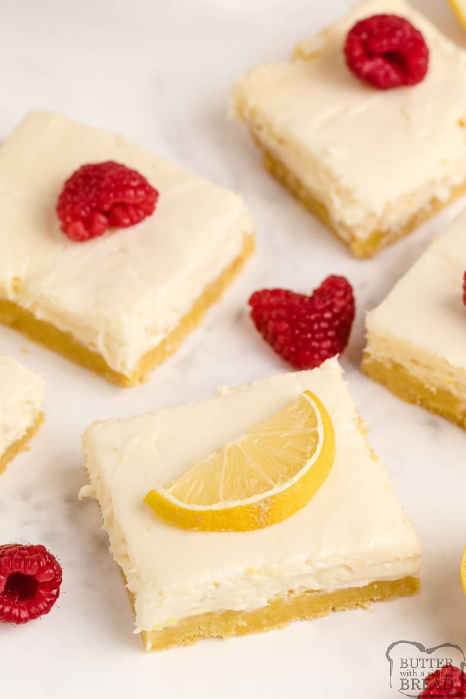 Lemon Cream Cheese Bars with a lemon cake mix crust, a vanilla cream cheese filling and a lemon cream cheese topping. Simple and delicious layered lemon bar recipe!