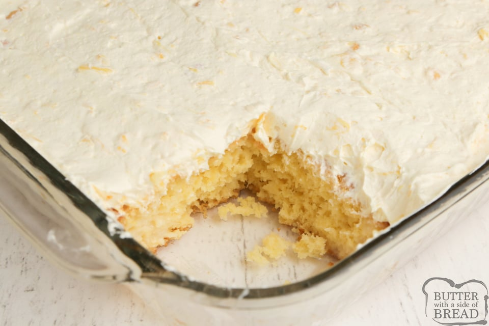 Pina Colada Poke Cake made with acake mix, crushed pineapple and a delicious, creamy pina colada sauce. Easy poke cake recipe topped with a light, refreshing pineapple pudding topping.