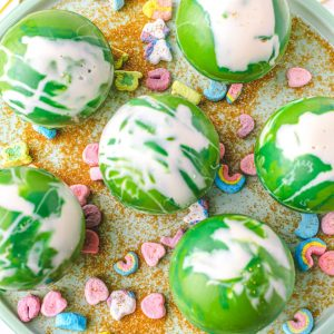 Festive St. Patrick's Day Hot Chocolate Bombs with Lucky Charms marshmallows