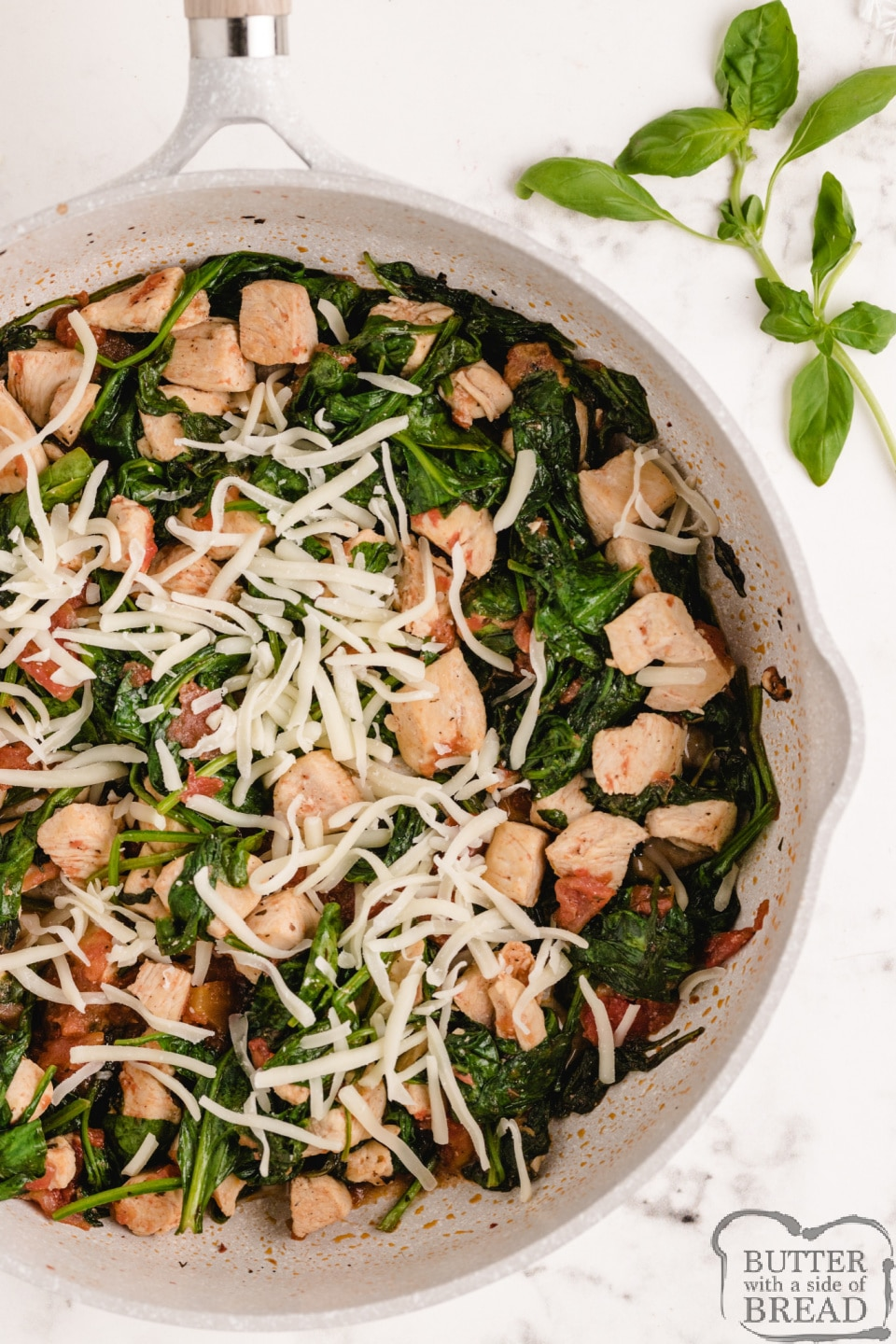 One pot chicken dinner with spinach, tomatoes and mozzarella