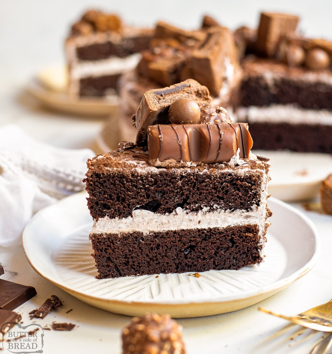 slice of chocolate cake with whipped cream frosting