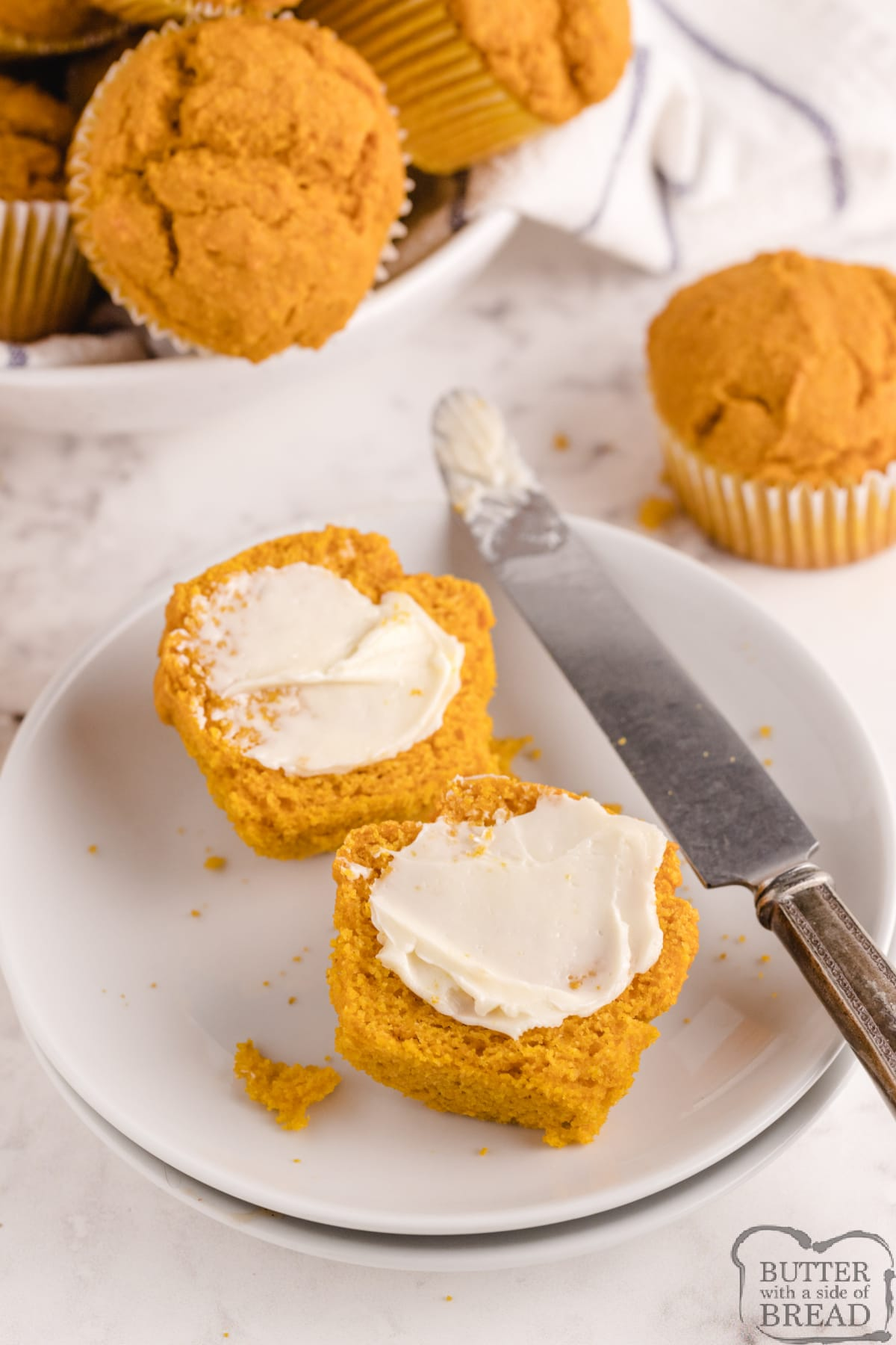 Pumpkin Corn Muffins made with pumpkin, corn meal and a few other basic ingredients. Delicious cornbread muffin recipe that is made even better with the addition of pumpkin.