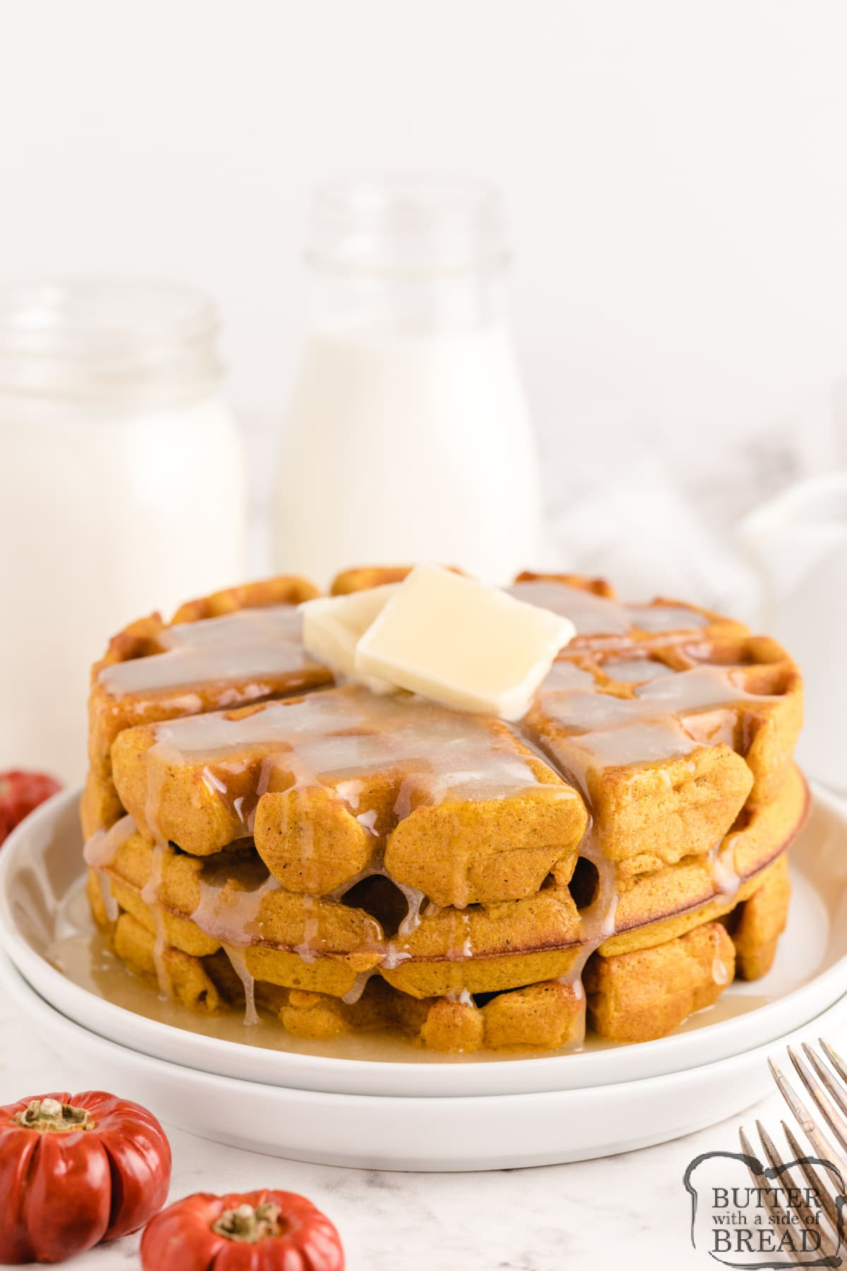 Perfect Pumpkin Waffles are a favorite fall breakfast. Easy pumpkin waffle recipe made with canned pumpkin and then topped with a simple homemade buttermilk syrup that is incredible!