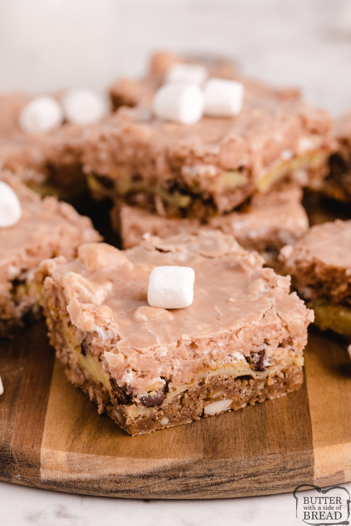 made with three layers of chocolate, marshmallows and almonds. Delicious Rocky Road dessert recipe that is easy to make and tastes like a cross between cheesecake and fudge!